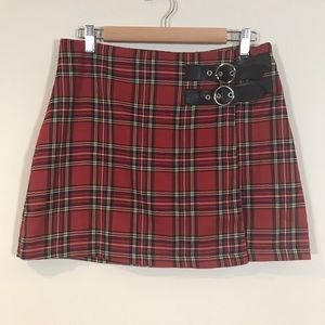 Women's red plaid skirt with buckles